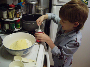 Isaiah_making_carrot_blueberry_brea